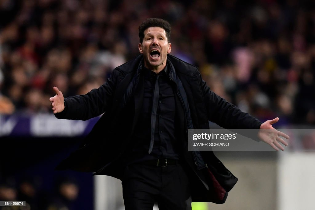 Atletico Madrid's Argentinian coach Diego Simeone reacts during the Spanish league football match Club Atletico de Madrid vs Real Sociedad at the Wanda Metropolitano stadium in Madrid on December 2, 2017. /