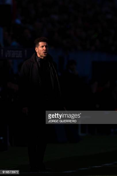 Atletico Madrid's Argentinian coach Diego Simeone reacts during the Spanish league football match between Malaga CF and Club Atletico de Madrid at La...
