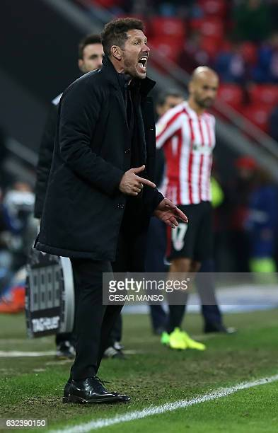 Atletico Madrid's Argentinian coach Diego Simeone shouts from the sideline during the Spanish league football match Athletic Club Bilbao vs Club...
