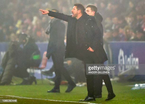 Atletico Madrid's Argentinian coach Diego Simeone shouts instructions to his players during the Spanish League football match between SD Huesca and...