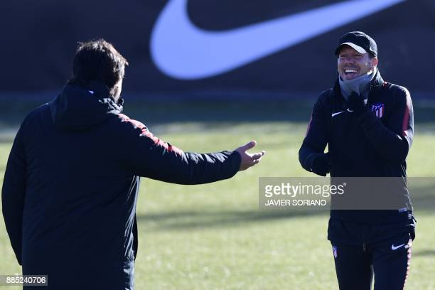 Atletico Madrid's Argentinian coach Diego Simeone smiles during a training session at Atletico de Madrid's sport city in Majadahonda near Madrid on...