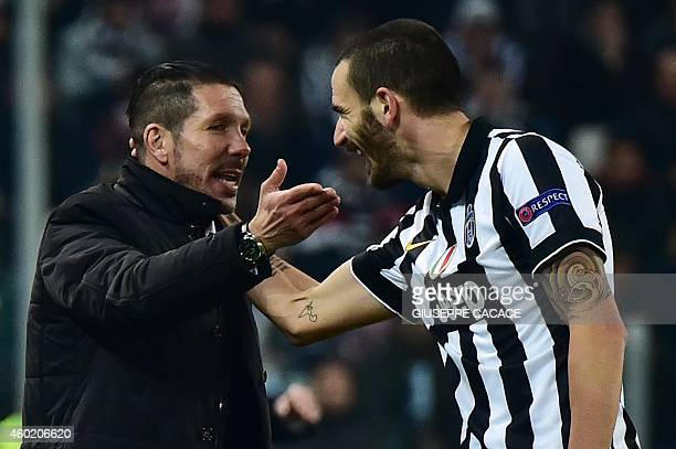Atletico Madrid's Argentinian coach Diego Simeone speaks with Juventus' defender Leonardo Bonucci during the UEFA Champions League football match...