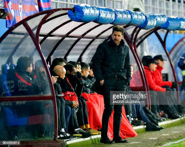 Atletico Madrid's Argentinian coach Diego Simeone stands next to the bench during the Spanish league football match between SD Eibar and Club...