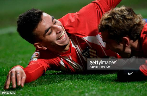 Atletico Madrid's Argentinian forward Angel Correa celebrates a goal with Atletico Madrid's French forward Antoine Griezmann during the Spanish...