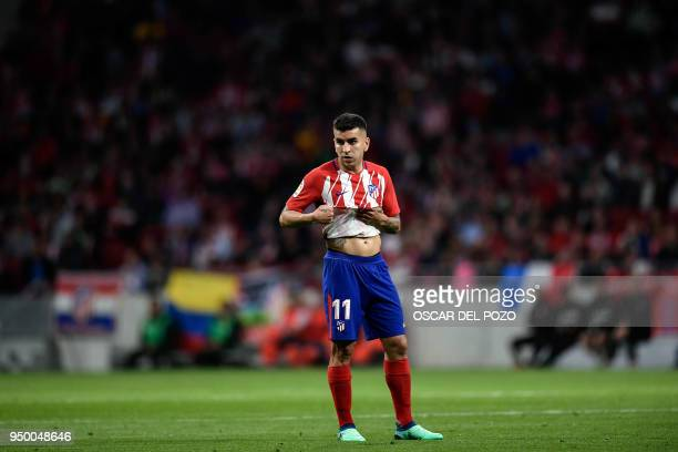 Atletico Madrid's Argentinian forward Angel Correa gestures during the Spanish league football match between Club Atletico de Madrid and Real Betis...