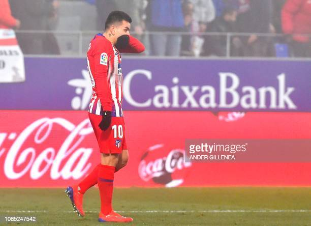 Atletico Madrid's Argentinian forward Angel Correa reacts during the Spanish League football match between SD Huesca and Atletico Madrid at the El...