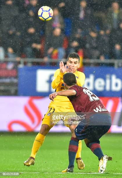 Atletico Madrid's Argentinian forward Angel Correa vies with Eibar's Spanish defender Jose Angel during the Spanish league football match between SD...