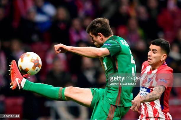 Atletico Madrid's Argentinian forward Angel Correa vies with Lokomotiv Moscow's Serbian defender Nemanja Pejcinovic during the Europa League Round of...