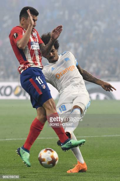 Atletico Madrid's Argentinian forward Angel Correa vies with Marseille's Brazilian midfielder Luiz Gustavo during the UEFA Europa League final...