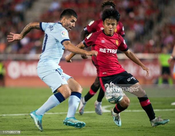 Atletico Madrid's Argentinian forward Angel Correa vies with Mallorca's Japanese midfielder Takefusa Kubo during the Spanish league football match...