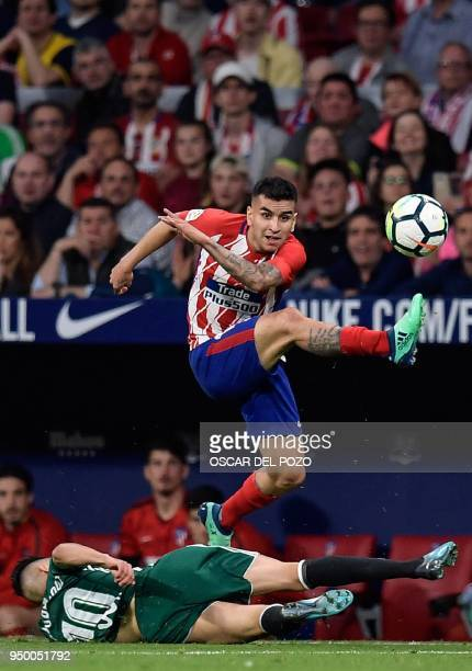 Atletico Madrid's Argentinian forward Angel Correa vies with Real Betis' Algerian midfielder Ryad Boudebouz during the Spanish league football match...