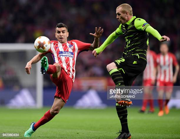 Atletico Madrid's Argentinian forward Angel Correa vies with Sporting's Portuguese defender Jeremy Mathieu during the UEFA Europa League quarterfinal...