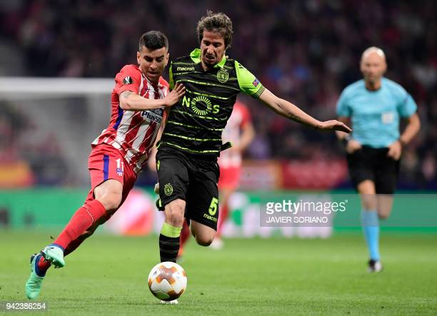 Atletico Madrid's Argentinian forward Angel Correa vies with Sporting's Portuguese midfielder Fabio Coentrao during the UEFA Europa League...