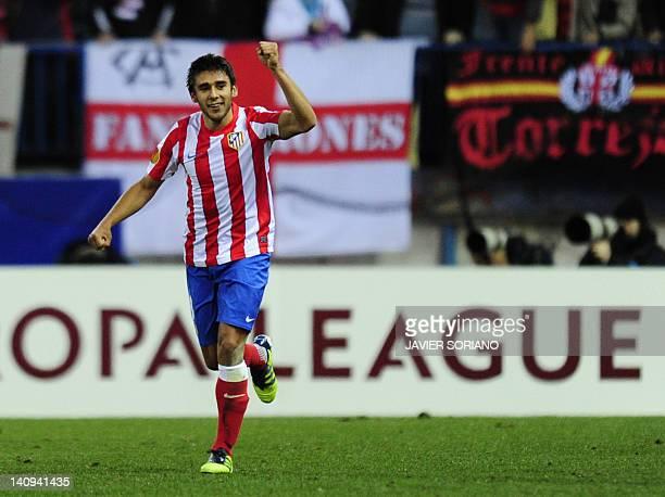 Atletico Madrid's Argentinian forward Eduardo Salvio celebrates after scoring their second goal during the UEFA Europa league round of 16 first-leg...