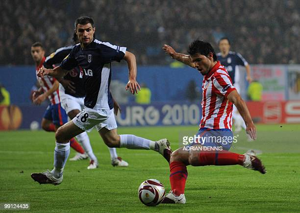 Atletico Madrid's Argentinian forward Sergio Aguero and Fulham's English striker Andrew Johnson vie for the ball during the final football match of...