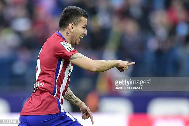 Atletico Madrid's Argentinian midfielder Angel Correa celebrates after scoring a goal during the Spanish league football match Club Atletico de...