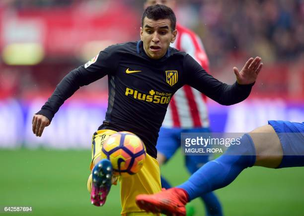 Atletico Madrid's Argentinian midfielder Angel Correa controls the ball during the Spanish league football match Real Sporting de Gijon vs Club...