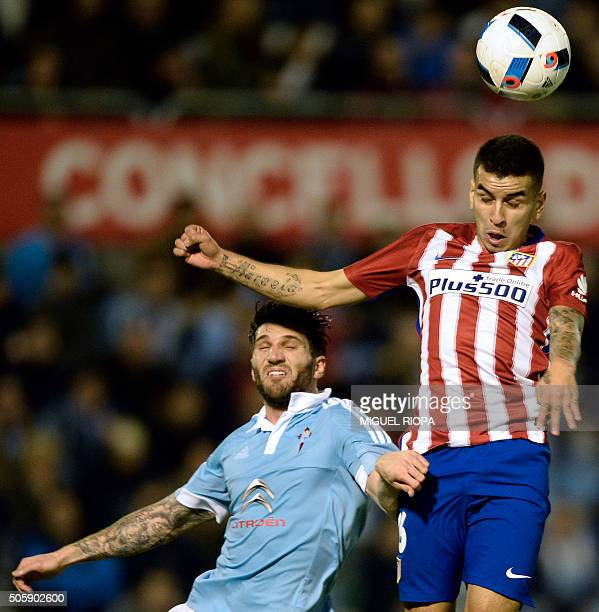 Atletico Madrid's Argentinian midfielder Angel Correa heads the ball with Celta Vigo's defender Carles Planas during the Spanish Copa del Rey...