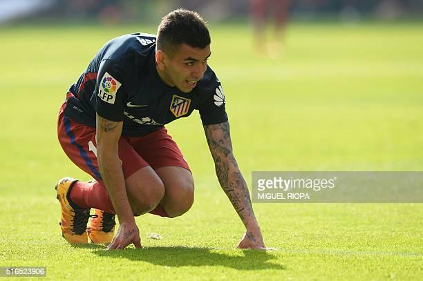 Atletico Madrid's Argentinian midfielder Angel Correa kneels during the Spanish league football match Real Sporting de Gijon vs Club Atletico de...