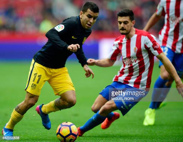 Atletico Madrid's Argentinian midfielder Angel Correa vies with Sporting Gijon's defender Roberto Canella during the Spanish league football match...