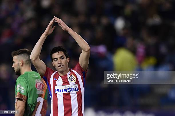 Atletico Madrid's Argentinian midfielder Nicolas Gaitan celebrates after scoring during the Spanish Copa del Rey round of 32 second leg football...