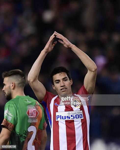 Atletico Madrid's Argentinian midfielder Nicolas Gaitan celebrates after scoring during the Spanish Copa del Rey round of 32 second leg football...