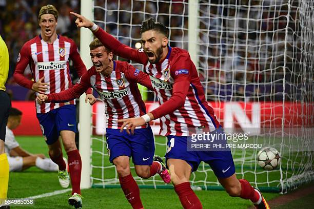 Atletico Madrid's Belgian forward Yannick Ferreira Carrasco celebrates next to Atletico Madrid's French forward Antoine Griezmann after scoring a...
