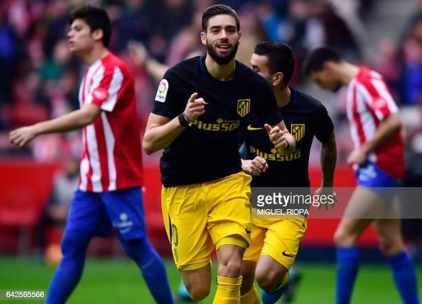 Atletico Madrid's Belgian forward Yannick Ferreira Carrasco celebrates after scoring a goal during the Spanish league football match Real Sporting de...