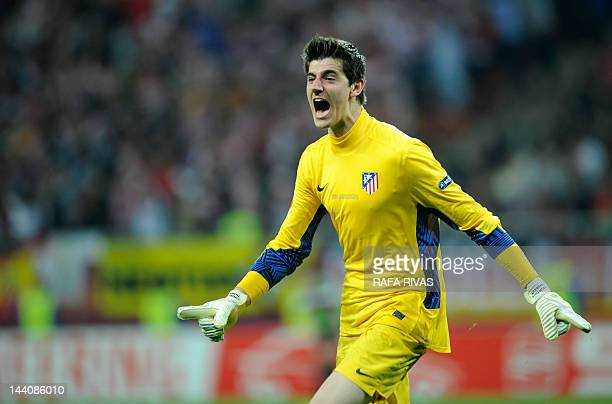 Atletico Madrid's Belgian goalkeeper Thibaut Courtois celebrates after winning the UEFA Europa League final football match between Club Atletico...