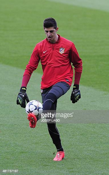 Atletico Madrid's Belgian goalkeeper Thibaut Courtois takes part in a training session at the Camp Nou stadium in Barcelona on March 31 on the eve of...