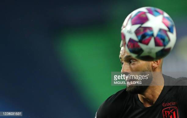Atletico Madrid's Belgian midfielder Yannick Carrasco runs for the ball during the UEFA Champions League quarter-final football match between Leipzig...