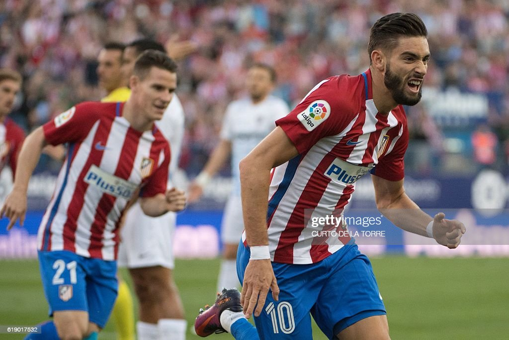 Atletico Madrid's Belgian midfielder Yannick Ferreira Carrasco celebrates a goal during the Spanish league football match between Club Atletico de Madrid and Malaga CF at the Vicente Calderon stadium in Madrid on October 29, 2016. / AFP / CURTO
