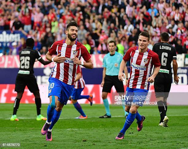 Atletico Madrid's Belgian midfielder Yannick Ferreira Carrasco celebrates after scoring during the Spanish league football match Club Atletico de...