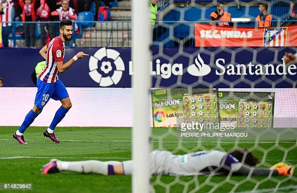 Atletico Madrid's Belgian midfielder Yannick Ferreira Carrasco celebrates after scoring his second goal during the Spanish league football match Club...