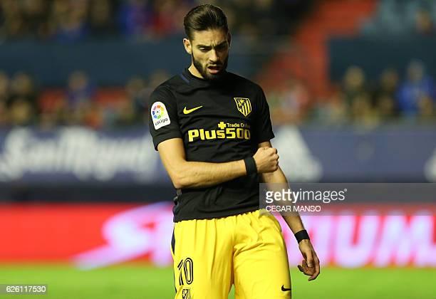 Atletico Madrid's Belgian midfielder Yannick Ferreira Carrasco celebrates after scoring during the Spanish league football match CA Osasuna vs Club...