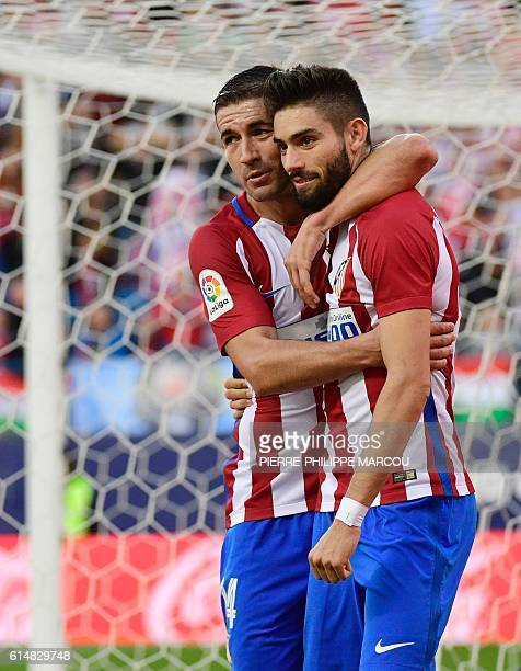 Atletico Madrid's Belgian midfielder Yannick Ferreira Carrasco celebrates with Atletico Madrid's midfielder Gabi after scoring his second goal during...