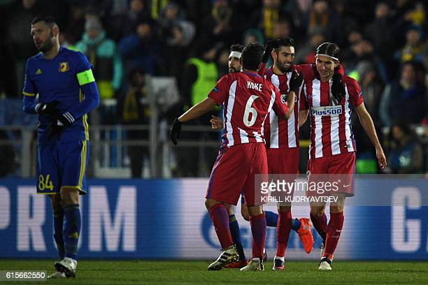 Atletico Madrid's Belgian midfielder Yannick Ferreira Carrasco celebrates with teammates after scoring a goal during the UEFA Champions League...