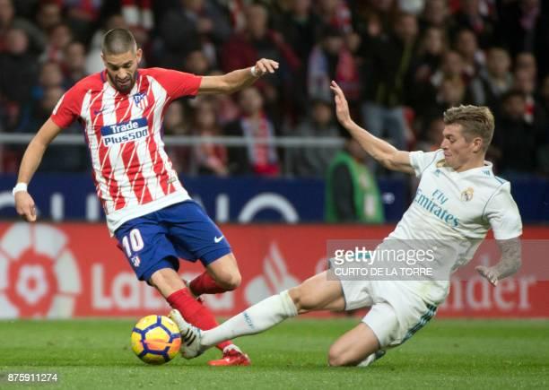 TOPSHOT Atletico Madrid's Belgian midfielder Yannick FerreiraCarrasco vies with Real Madrid's German midfielder Toni Kroos during the Spanish league...