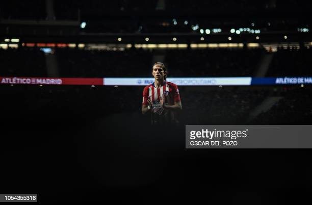 TOPSHOT Atletico Madrid's Brazilian defender Filipe Luis applauds to fans after scoring a goal during the Spanish league football match between Club...