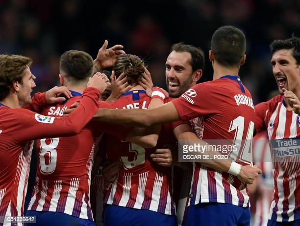 Atletico Madrid's Brazilian defender Filipe Luis celebrates a goal with teammates during the Spanish league football match between Club Atletico de...