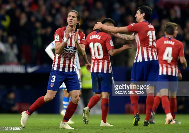 Atletico Madrid's Brazilian defender Filipe Luis celebrates a goal during the Spanish league football match between Club Atletico de Madrid and Real...