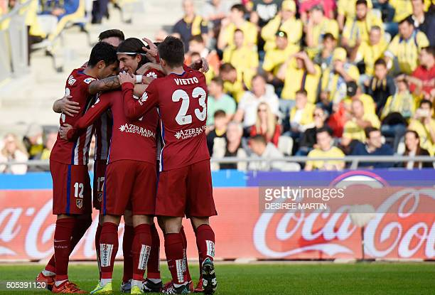 Atletico Madrid's Brazilian defender Filipe Luis celebrates with teammates after scoring during the Spanish league football match UD Las Palmas vs...