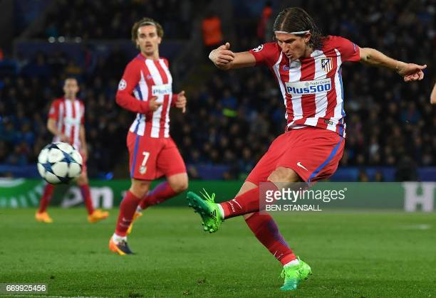 Atletico Madrid's Brazilian defender Filipe Luis shoots but fails to score during the UEFA Champions League quarterfinal second leg football match...
