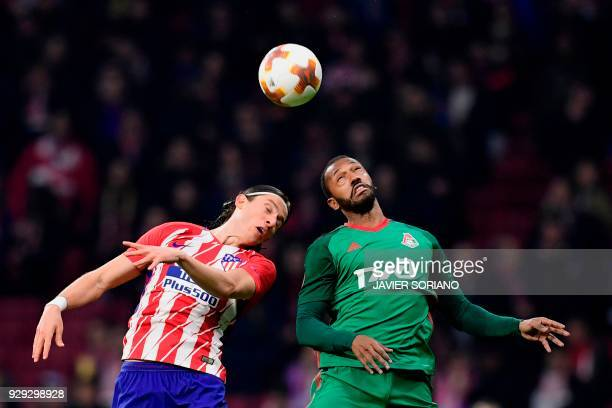 Atletico Madrid's Brazilian defender Filipe Luis vies with Lokomotiv Moscow's Portuguese midfielder Manuel Fernandes during the Europa League Round...