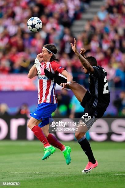 Atletico Madrid's Brazilian defender Filipe Luis vies with Real Madrid's Brazilian defender Danilo during the UEFA Champions League semi final second...