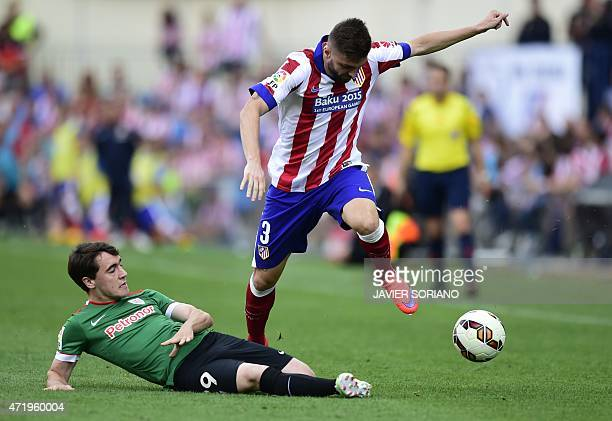 Atletico Madrid's Brazilian defender Guilherme Siqueira vies with Athletic Bilbao's midfielder Unai Lopez during the Spanish league football match...
