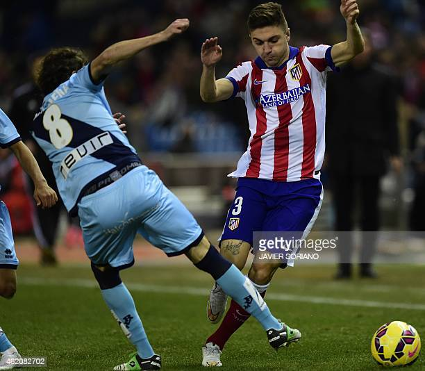 Atletico Madrid's Brazilian defender Guilherme Siqueira vies with Rayo Vallecano's midfielder Jose Baena during the Spanish League football match...