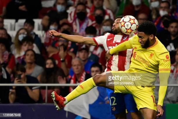 Atletico Madrid's Brazilian defender Renan Lodi vies with Liverpool's English defender Joe Gomez during the UEFA Champions League Group B football...