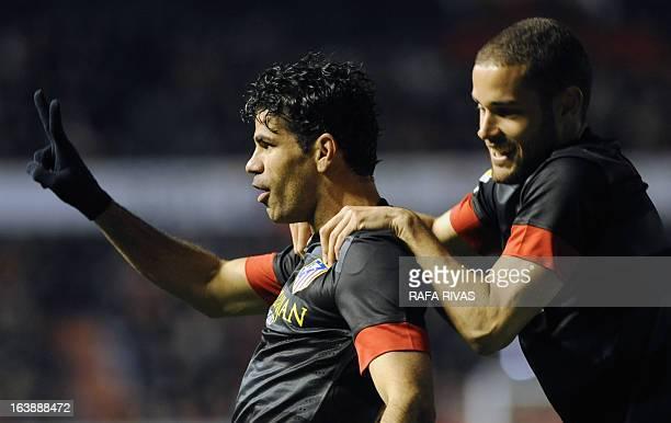 Atletico Madrid's Brazilian forward Diego da Silva Costa celebrates after scoring his second goal during the Spanish league football match Osasuna vs...