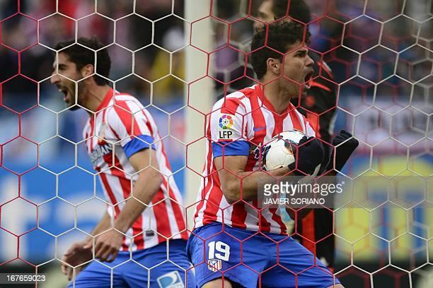 Atletico Madrid's Brazilian forward Diego da Silva Costa celebrates his team's first goal during the Spanish league football match Club Atletico de...